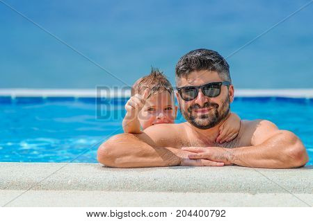 Seven Years Old Cute Boy Smiling Without Tooth. He And His Bearded Father Are In Sunglasses, Show Th