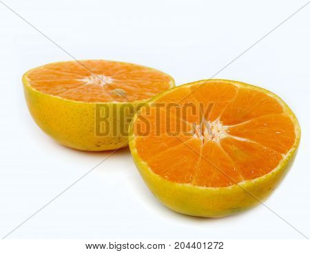 Half of ripe orange fruits isolated on white background.