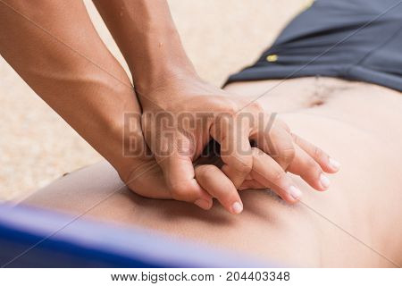 man use hand push chest compression cpr training