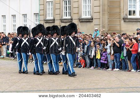 Copenhagen Denmark - July 24 2017: Tourists are visiting Amalienborg Palace Square in Copenhagen during changing of Royal Guards.