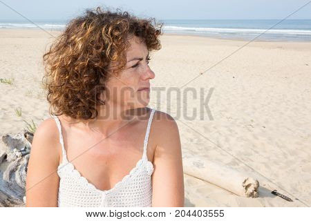 Close-up Of A Sad And Depressed Woman Deep In Thought Outdoors