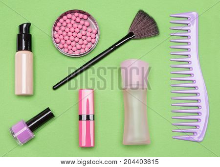 Contents of cosmetic bag: foundation, blush, lipstick, nail polish, makeup brush, perfume body spray and comb. Required beauty attributes