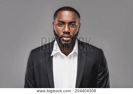 Stylish african american man on full suit