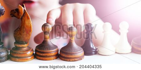 Cute Toddler Boy Playing Chess.
