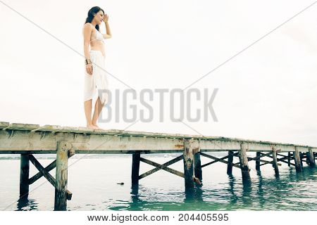 young woman by the sea in mallorca, spain
