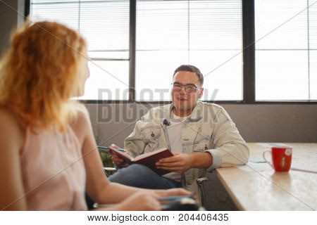 Two designers with laptop. Meeting in modern office.