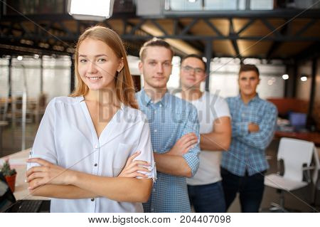 Happy youthful guys and lady getting ready for job interview. Start up concept.