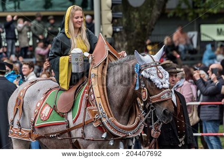 MUNICH GERMANY - 16 OCTOBER 2017: Münchner Kindl one of the Oktoberfest mascot in tent owners and breweries parade