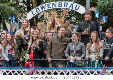 MUNICH GERMANY - 16 OCTOBER 2017: Tent owners and breweries parade at the beginning of Oktoberfest - Lowenbrau parade