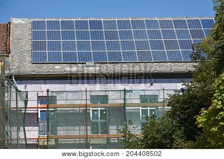 Solar panels on the roof of a building under construction