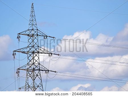 Electricity pylon against the sky in summer