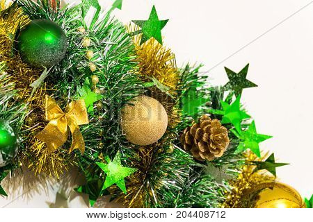 Christmas decoration of tinsel bows balls beads cones and stars