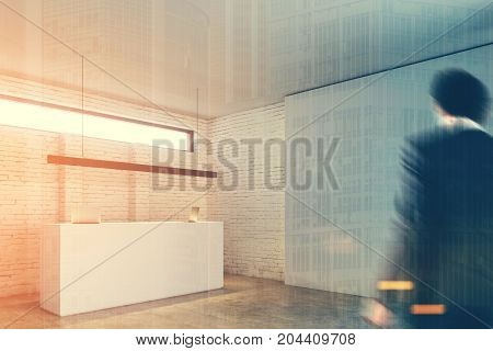 White reception table with two laptops is standing in a white brick wall office lobby under a narrow horizontal window. Side view. 3d rendering mock up toned image double exposure