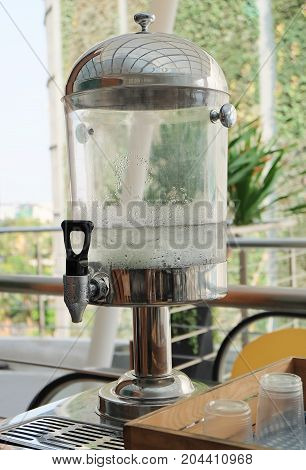 Kitchen Utensil Empty Glasses with Cool Water and Ice in Drinking Tank Container.