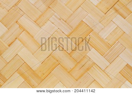 Background Pattern Brown Square Handicraft Weave Texture Wicker of Bamboo Plant for Furniture Material.