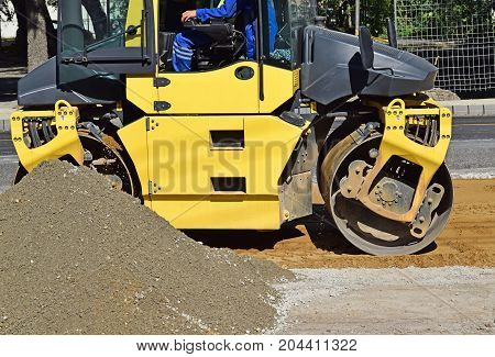 Road roller at work at the road construction