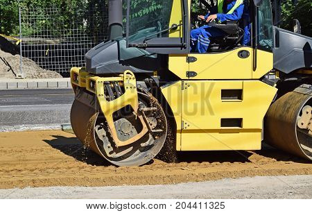 Road roller at the road construction in the city