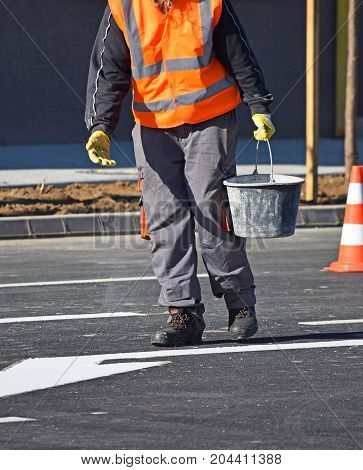 Worker at the road cosntruction in the city