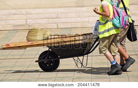 Men with a wheelbarrow on the street