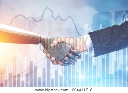 Close up of a businessman in a suit and a robot shaking hands. Blurred background. Graphs. Concept of innovation in business. Toned image double exposure