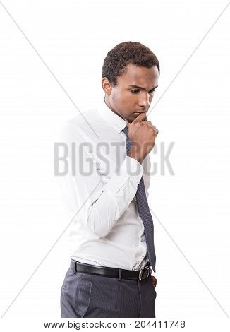 Isolated portrait of a young pensive African American businessman wearing a white shirt and a gray tie.