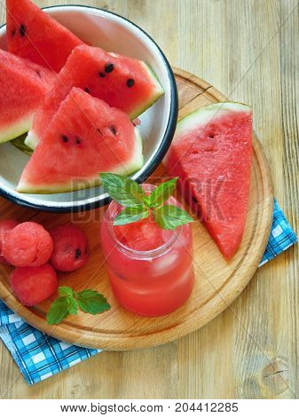 Watermelon segments and a refreshing drink ice and decorated with mint
