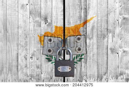 Cyprus flag on door with padlock close