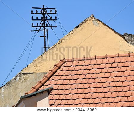House roofs and telephone line in the city