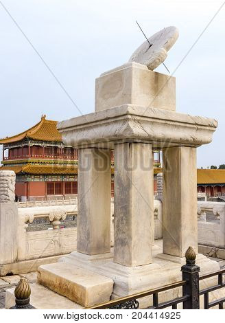Beijing, China - Oct 30, 2016: The sundial, an ancient time calculagraph, at the Hall of Supreme Harmony (Taihedian). Forbidden City (Gu Gong, Palace Museum).