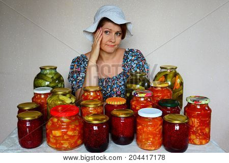 Sad woman sits with a homemade preserves