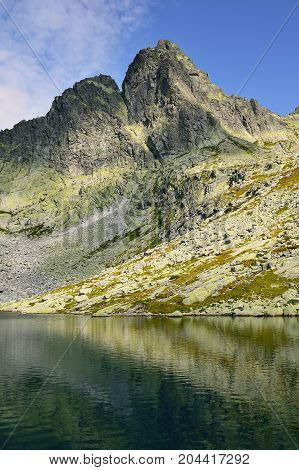 High Tatras in Slovakia. Monumental peaks. Summer scenic landscape mountain view. Alpine trail. Ostry peak and Sive tarn in Big cold valley.