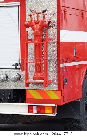Fire hydrant - a device for taking water from a water supply system for fire fighting.Is the kit a fire truck.