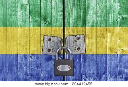 Gabon flag on door with padlock close