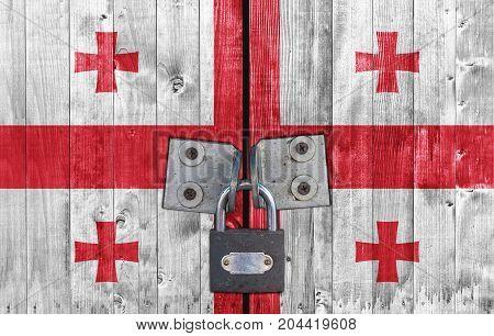Georgia flag on door with padlock close