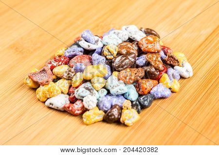 Pile Of Chocolate Rock Candy On A Wood Background