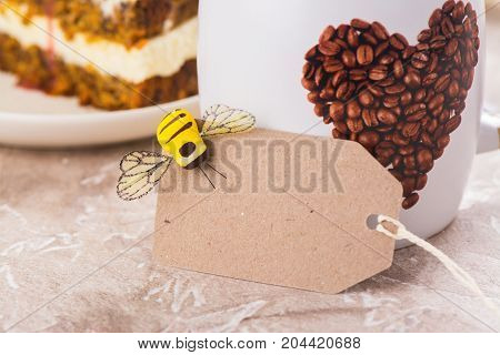 Mug of coffee and craft paper tag. Bee my Valentine concept. Space for text