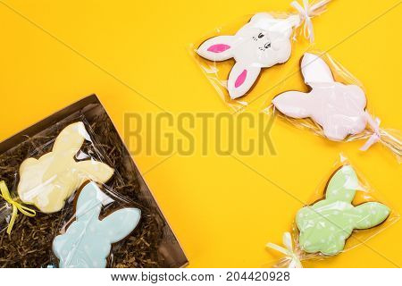 Easter cookies over yellow background. Funny bunnies. Space for text