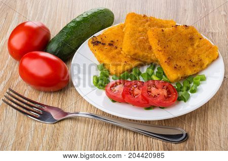 Fish In Breadcrumbs, Tomatoes, Scallion On White Plate And Fork
