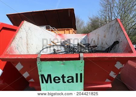 Skip container with scrap metal for recycling