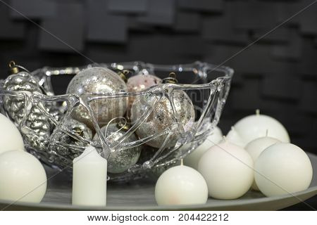 White Candles Decorated On A Plate