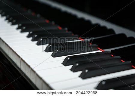 Piano keys on black classical grand piano play