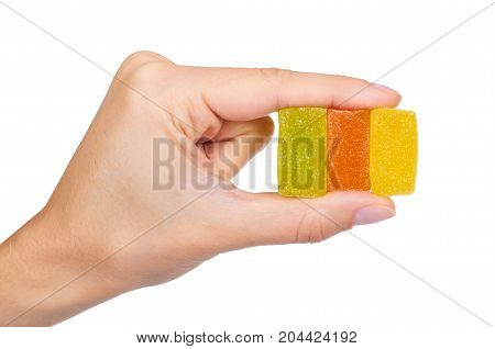 Various Color Of Fruity Gummy Jelly Candies In Hand Isolated On White Background