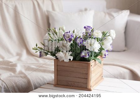Wooden Box With Fresh Flowers In The Interior Of The Room
