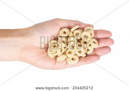 Beige Rings Corn Flakes In Hand Isolated On White Background