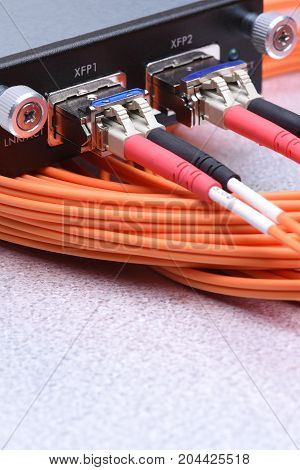 Network optical fiber cables connected to gigabit interface converter