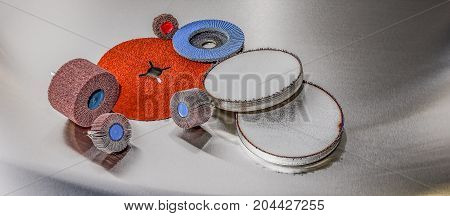 discs abrasive flap wheels on metallic background. abrasive discs and metal before processing
