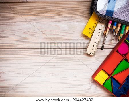 Primary school supplies on the wooden background. School concept