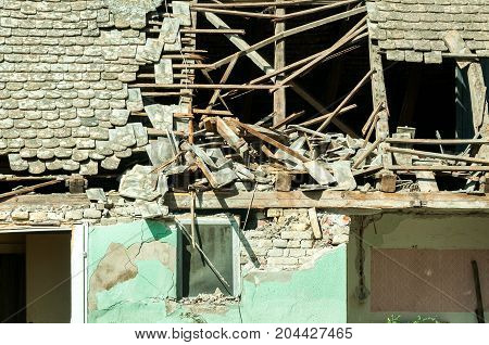 Abandoned civilian house in Eastern Ukraine damaged by grenade explosion in the war zone