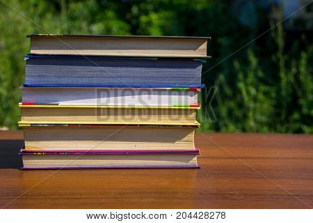 Stack Of The Books On Wooden Table Outdoor
