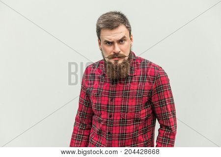 Handsome Businessman With Beard And Handlebar Mustache Looking At Camera With Angry Face